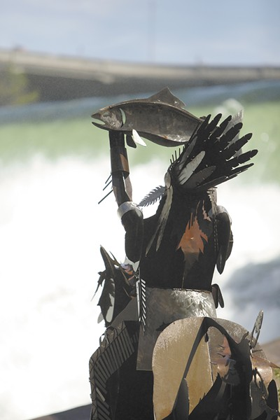The Salmon Chief, located at Spokane's new Huntington Park along the lower falls of the Spokane River, raises a salmon to bless the river.