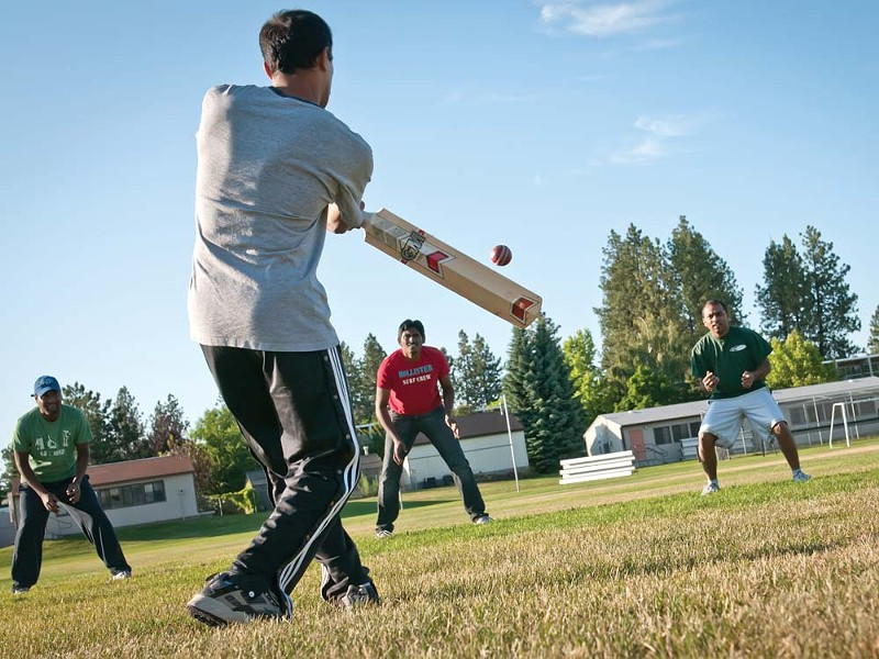 The Spokane Spartans take batting practice. - AMY HUNTER
