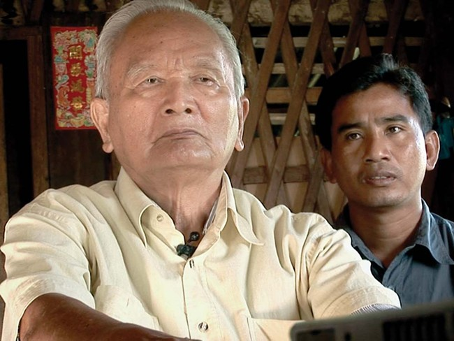 Thet Sambath, right, with Pol Pot's right hand.