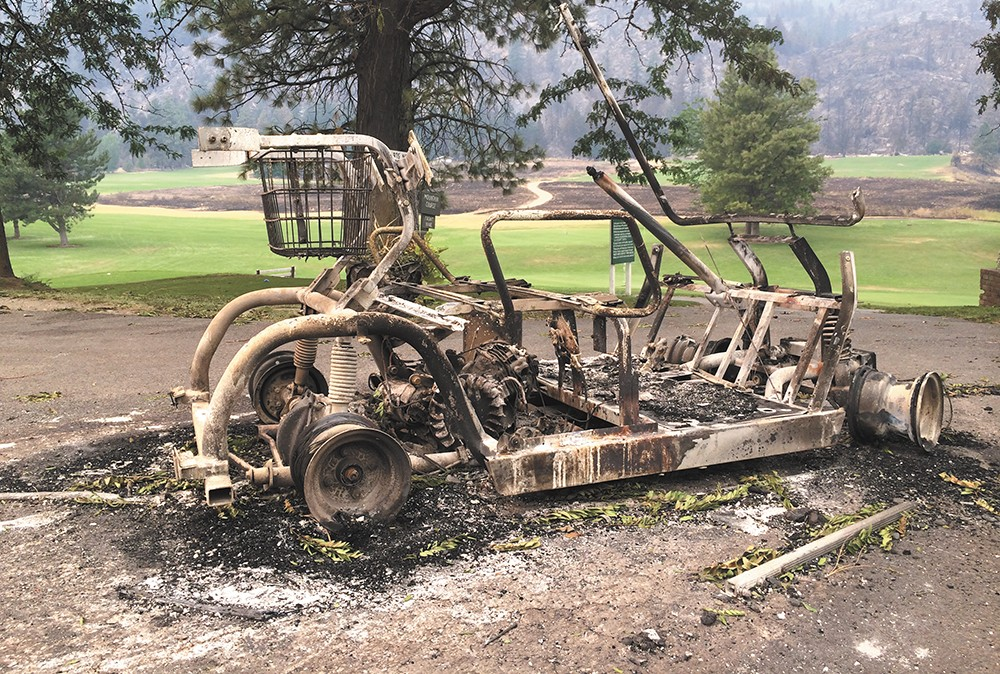 This golf cart near Alta Lake was incinerated, while the Carlton Complex fire jumped most of the course itself. - SCOTT A. LEADINGHAM