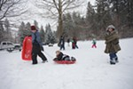 Thomas Bakken, left, pulls his daughter on a sled as his son follows.