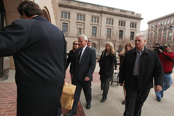 Karl Thompson, center, walks into the Thomas S. Foley U.S. Courthouse in Spokane, Wash. on Thursday, November 15, 2012 for a sentencing hearing for his role in the death of Otto Zehm. - YOUNG KWAK