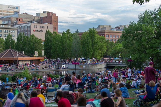 Thousands of people gathered in Riverfront Park to listen to music, enjoy the weather and watch the firework display. - MATT WEIGAND