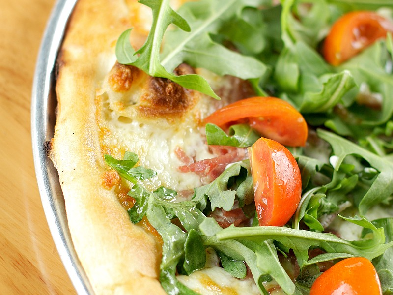 Three years after opening, pies like the prosciutto pizza continue to make South Perry a neighborhood favorite.