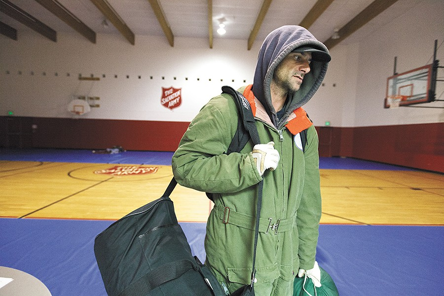Tim Henry, of Las Vegas, seeks shelter in a local warming center as he makes his way south. - YOUNG KWAK