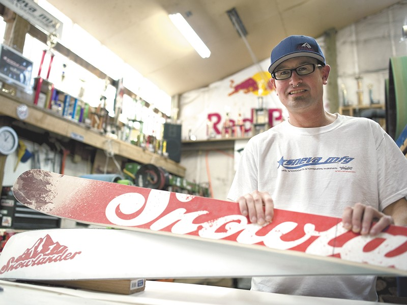 TJ Sneva with a pair of custom skis he was hired to build for Snowlander. - CHRISTIAN WILSON