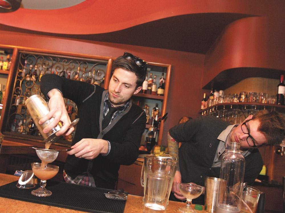 Topher Webber pours his own Blinker, bartender Shawn Heale watching over him. - YOUNG KWAK