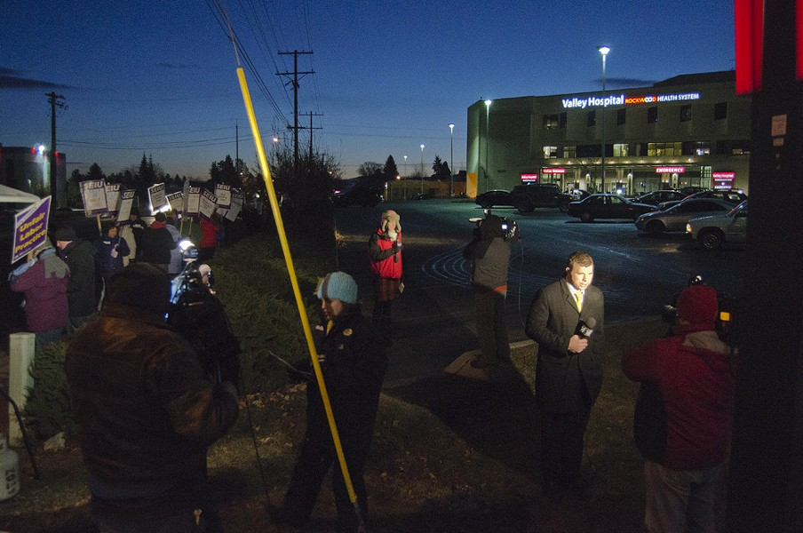 TV news crews broadcast live from the picket line at Valley Hospital. - JACOB JONES