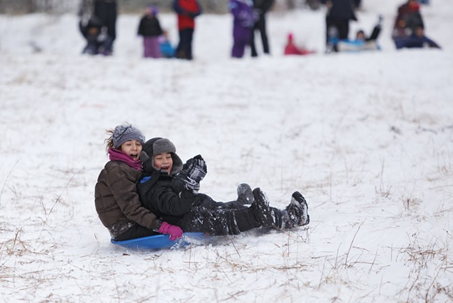 Twelve-year-old Lakaija Dunbar, left, and her 6-year-old brother, Desean, sled at Underhill Park. - YOUNG KWAK