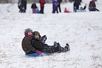 Twelve-year-old Lakaija Dunbar, left, and her 6-year-old brother, Desean, sled at Underhill Park.