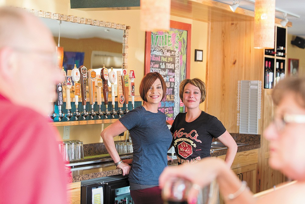 Twin sisters Emily Redington and Mel Wood recently bought the Hop Shop. - WATT WEIGAND