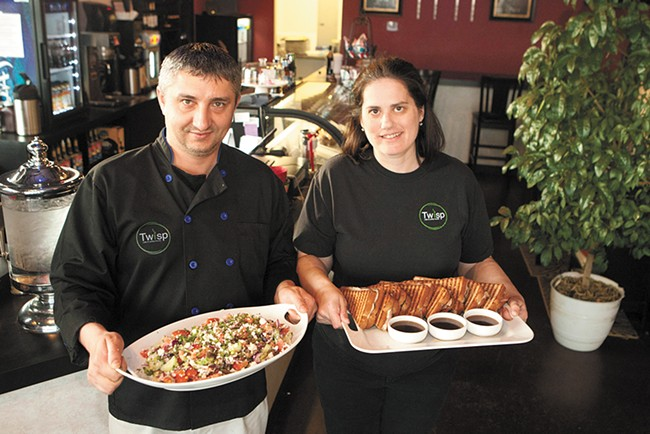 Twisp Cafe owners Bobby (left) and Stacy Taninchev with a Greek salad and French dip panini. - MEGHAN KIRK