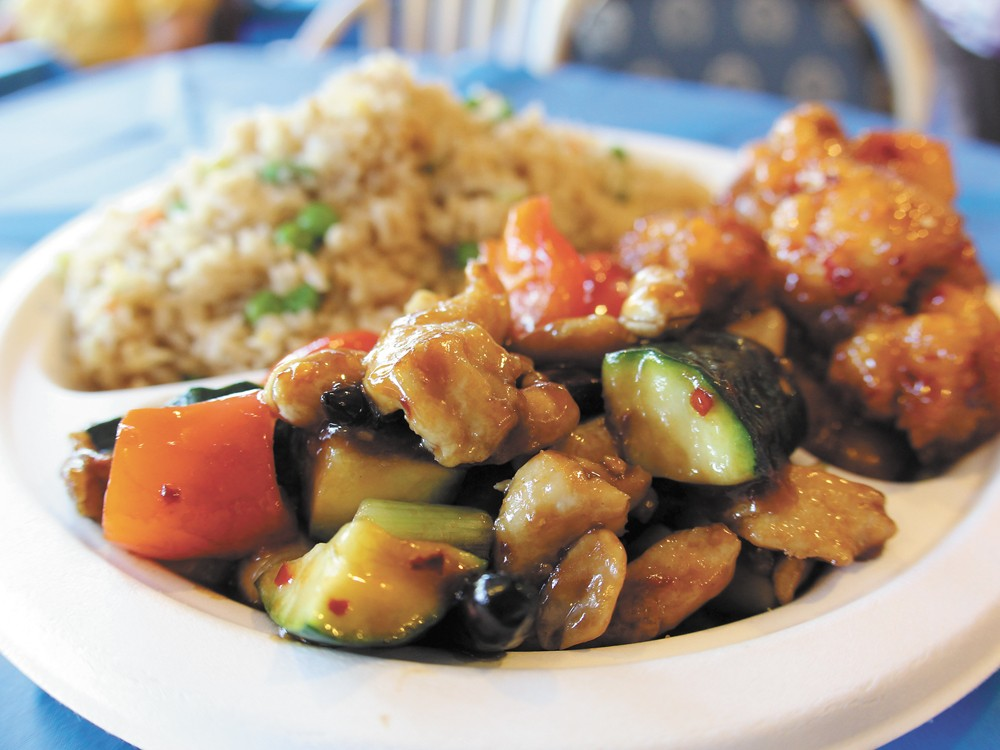 Two entrees and a side set you back just $6.50 at Happy Dragon. - JOE KONEK