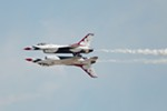 Two U.S. Air Force Thunderbirds Air Demonstration Squadron F-16s perform.