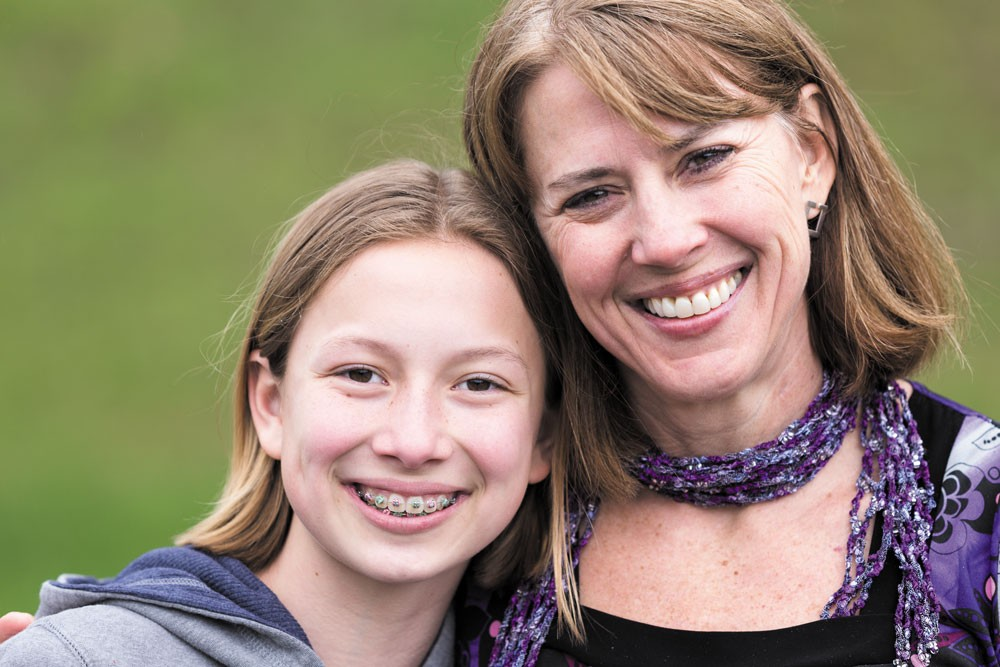 Twyla-Lea Jensen flashes her new smile alongside her daughter Landyn. - STEPHEN SCHLANGE