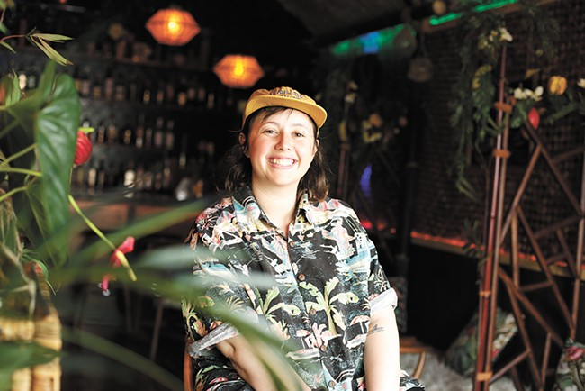 Escape the city rush inside Claire Fieberg's tropical bar oasis. - YOUNG KWAK