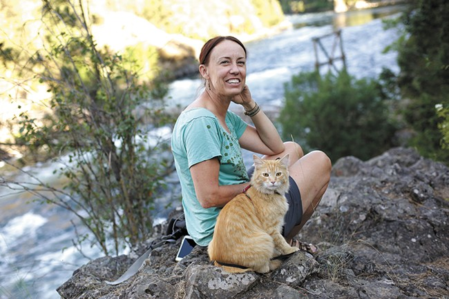 Megan Ferney takes her rescued adventure cat Leon on hikes, camping trips and even paddleboarding. - YOUNG KWAK