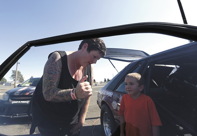 Rachelle Stephens shows off  her 1984 Ford Mustang GT to 6-year-old Jacen Lake. - YOUNG KWAK
