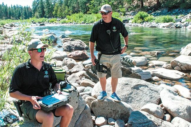 Spokane County Sheriff deputies Brad Humphrey and Jim Ebel conduct life-jacket emphasis patrols on the river last month. - DANIEL WALTERS PHOTO