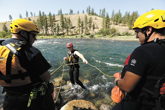 Members of the Spokane Fire Department's swift-water rescue team train with the technical rescue team, which uses ropes to rescue people in hard-to-reach places. - YOUNG KWAK