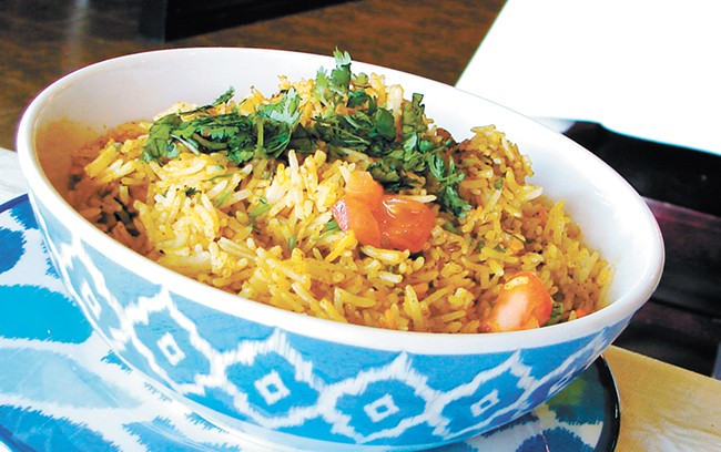Biryani, a rice dish, is cooked for hours to enhance flavor. - CARRIE SCOZZARO PHOTO