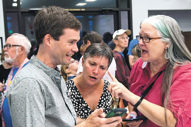 Local Democrats (from left) Andrew Biviano, Amy Biviano and Deb Conklin react to early primary election returns. - DANIEL WALTERS