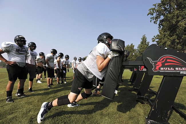 Each season, coaches teach Lewis and Clark High School football players how to avoid head injuries. - YOUNG KWAK
