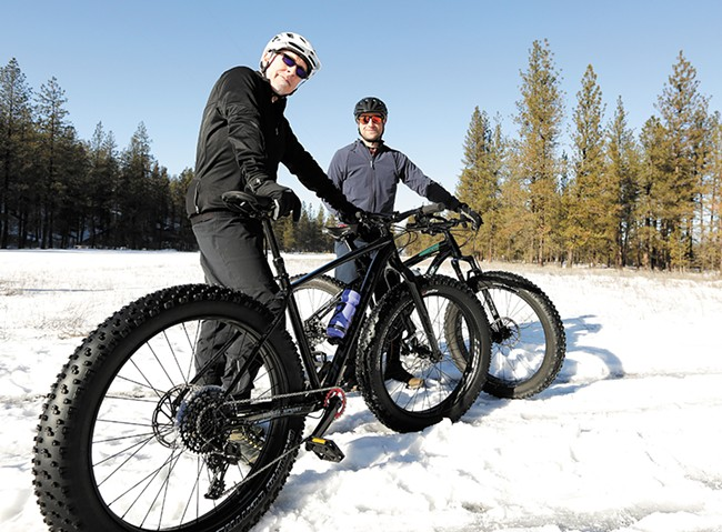 Wheelsport managers Greg Britton (left) and Trent Armstrong show off their fat-tire bikes. - YOUNG KWAK