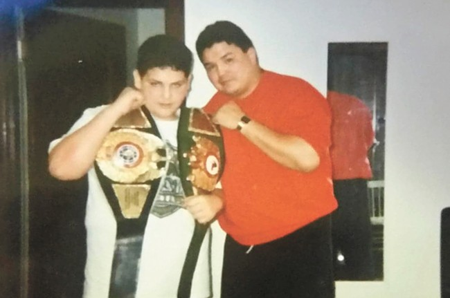 With his trainer, Joe Hipp.