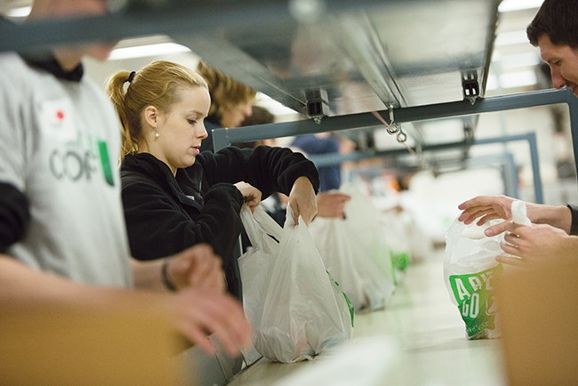 Volunteers sort donations at 2nd Harvest. - YOUNG KWAK