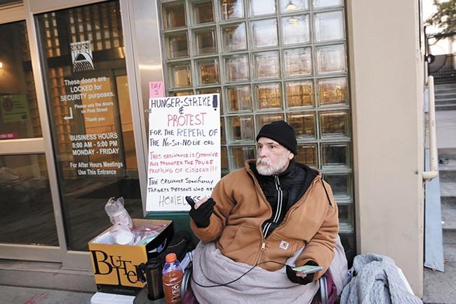 Alfredo LLamedo protests outside Spokane City Hall. - YOUNG KWAK