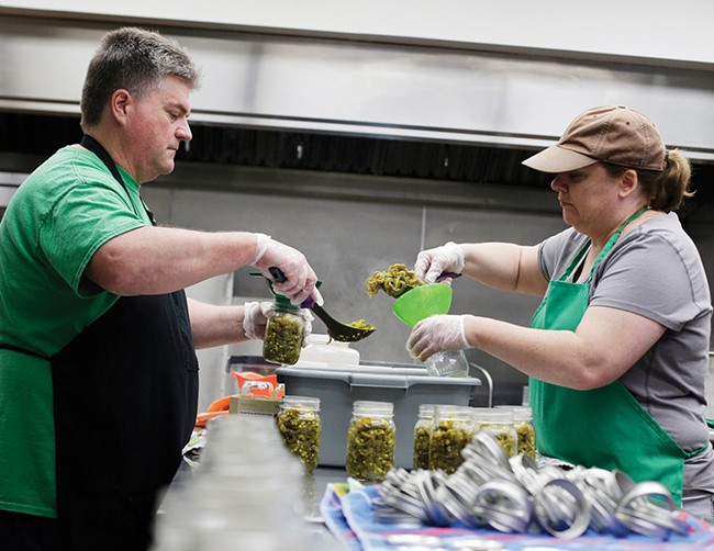 Bob Emmons and Gail Brock use Kitchen Spokane's commercial space to make B&G Sweet Heat Peppers. - YOUNG KWAK