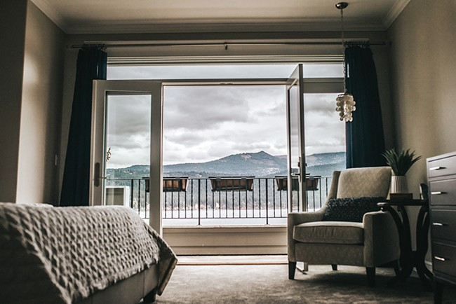 The Wozow master suite features soft colors, with an occasional pop of blue to complement, but not compete with , the sweeping Liberty Lake view. - ALICIA HAUFF PHOTO