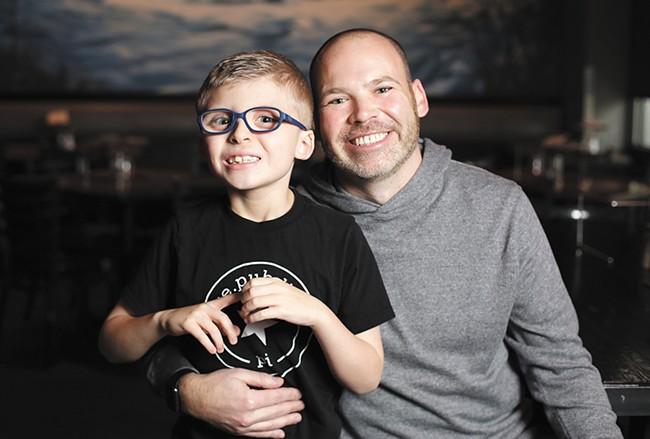 Flying Goat co-owner Jonathan Sweatt with his 7-year-old nephew Charlie, who inspired Sweatt to support the Spokane Guilds' School. - YOUNG KWAK