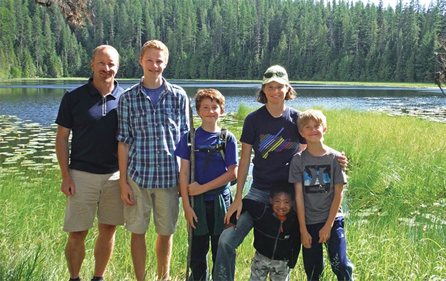 """""""We thought we need to share this information we gained from going to the parks and compile a resource that would be good for parents,"""" says Abby McAllister, pictured with her husband Harley and four of their kids at Glacier National Park. - ABBY MCALLISTER PHOTO"""