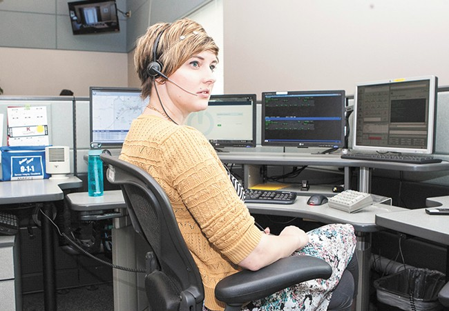 Marci Prettyman remains cool under pressure while fielding 911 calls. - MEGHAN KIRK