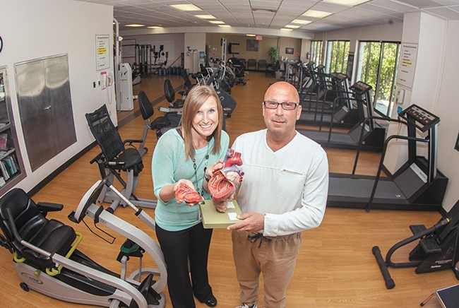 Jeff Zeiger with his physical therapist, Shaina Hicks, at St. Luke's. - MEGHAN KIRK