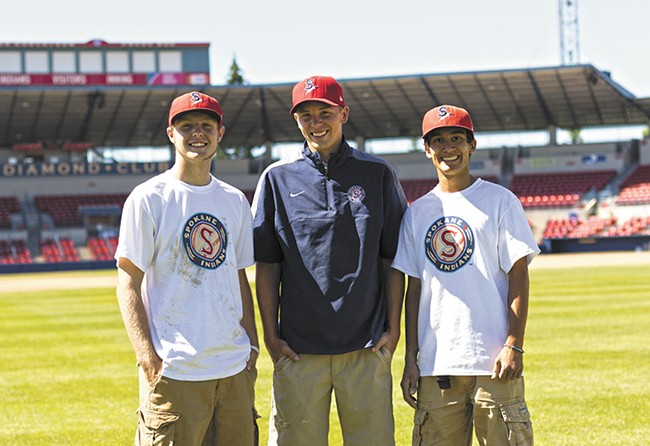 Yearout (center) with assistant groundskeepers Jacob Fender (left) and Daniel Ramirez. - YOUNG KWAK