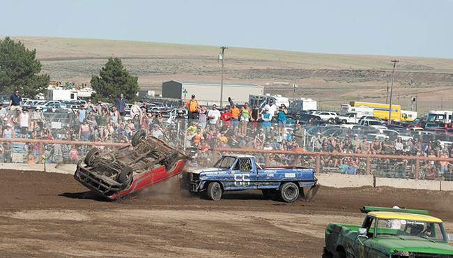 Full-contact truck races keep the action going between combine battles. - MEGHAN KIRK