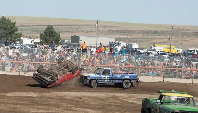 Full-contact truck races keep the action going between combine battles. - MEGHAN KIRK