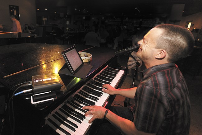 Christan Raxter takes on Steve Ridler during their Dueling Pianos show at the Ridler Piano Bar last weekend. - YOUNG KWAK