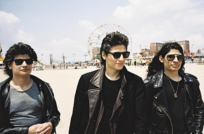 Three of the seven brothers documented in The Wolfpack.