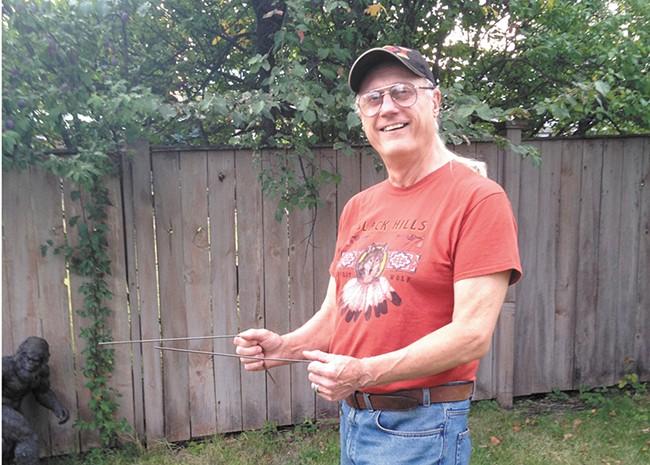 Kewaunee Lapseritis with his dowsing rods.