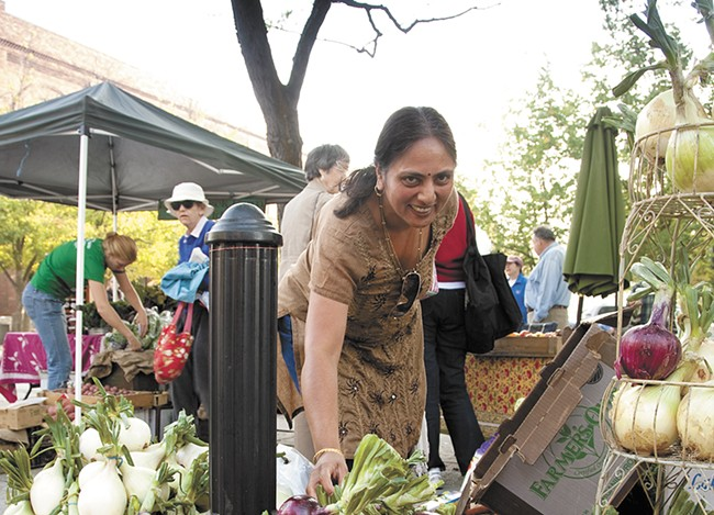 A customer looks through goods from Pokey Creek Farm at the Moscow Farmers Market. - ALISON MEYER