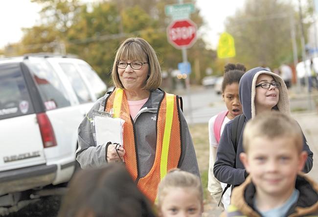 Volunteer Karen Chipley walks West Central kids to school once a week. - YOUNG KWAK
