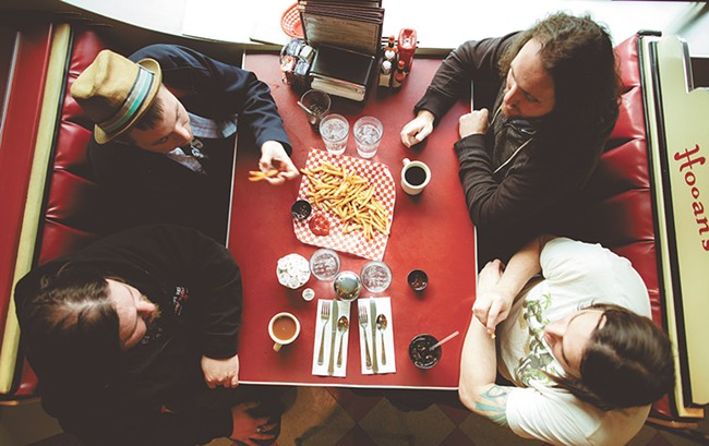 Local rockers Buffalo Jones, clockwise from top right, Jason Johnson, Glenn Case, Brandon Humphreys and Joshua Martin at Hogan's Diner. - KRISTEN BLACK