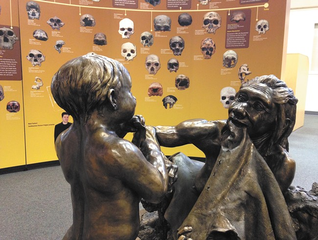 A statue depicting early humans at the North Spokane Library's collaboration with the Smithsonian. - MIKE BOOKEY