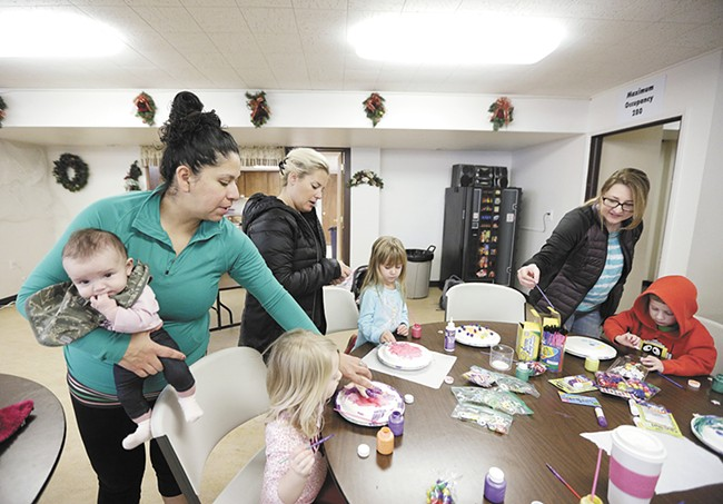 Melissa Strohe (left) and other mothers help their kids with a crafts activity during one of the North Spokane MOMS Club's weekly social events. - YOUNG KWAK