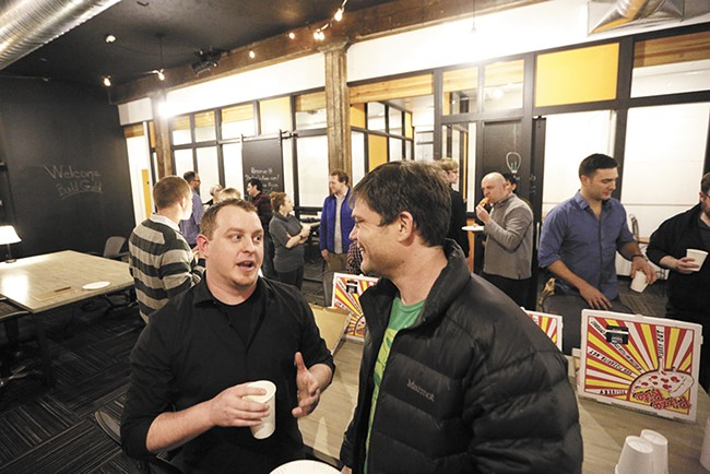 Build Guild coordinator Zach Shallbetter (left) visits with web developer Greg Neils during January's casual networking meetup for people of all backgrounds in the local tech/web industry. - YOUNG KWAK