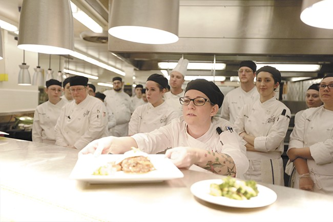 Inland Northwest Culinary Academy student Jessica Sullivan (center) with her Loco Moco dish. - YOUNG KWAK
